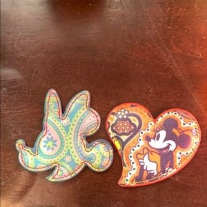 Two paisley Disney magnets
